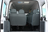 14-Seater Ford Transit rear view with 13+1 seats